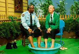 Mr. Rogers cools his feet with Officer Clemmons