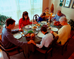 Family Praying at Thanksgiving