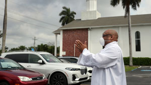 Pastor leading service in parking lot